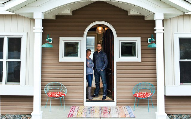 Glen and Alisha Perkins on their front porch