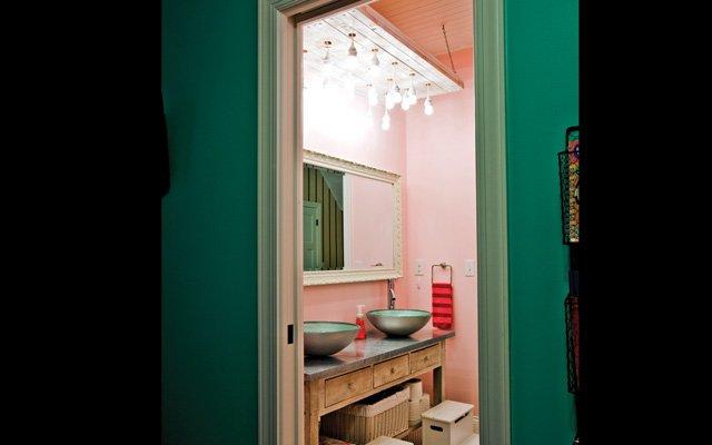 The girls' bathroom features DIY lighting—several IKEA ...