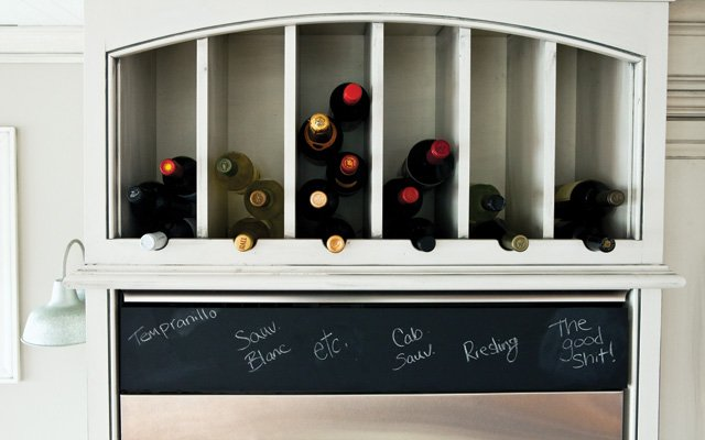 Built-in wine storage above the refrigerator.
