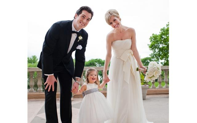 bride, groom and flower girl