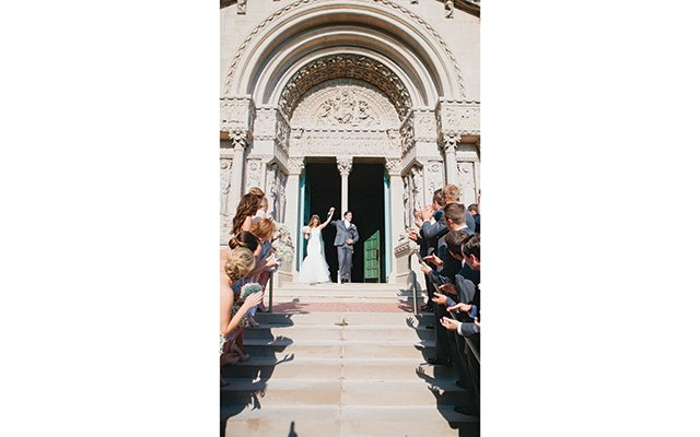 Bride and Groom leaving the building