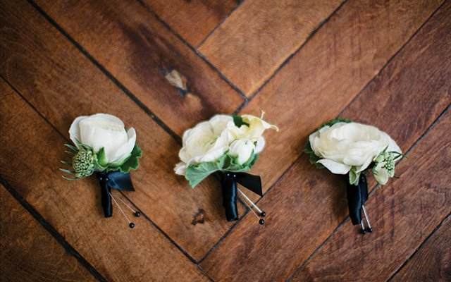 white ranunculus boutonnieres