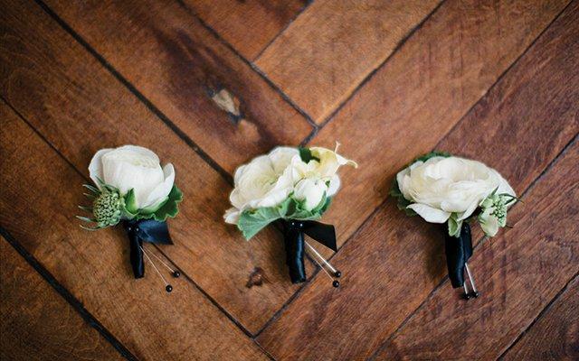 white ranunculus boutonnieres