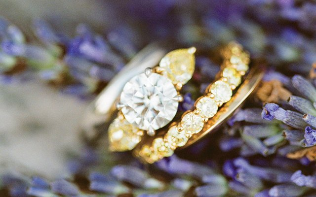 Bride and Groom wedding rings around lavender