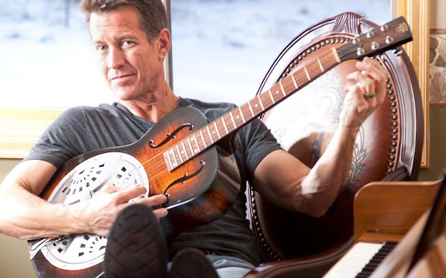 James Denton with guitar