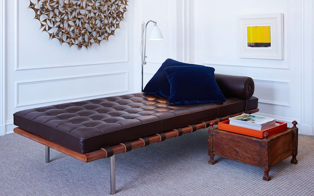 leather bed with blue pillows