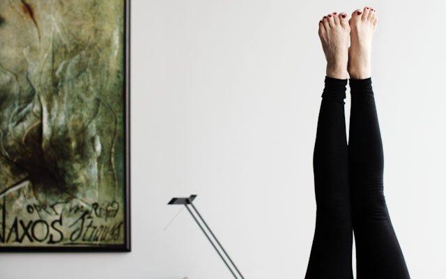 Sharmane Riemer feet in the air for yoga pose