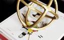 Gold circular metal sculpture