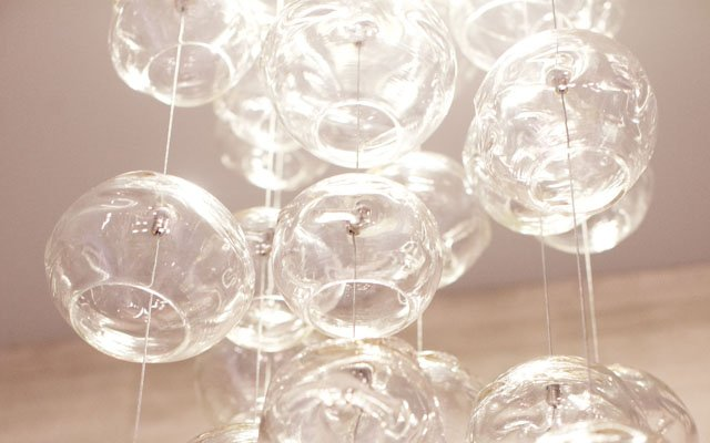 glass globes hanging from the ceiling as lights