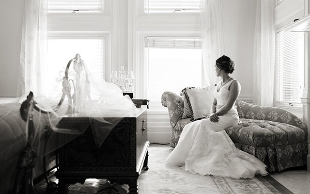 Bride sitting in room looking out the window