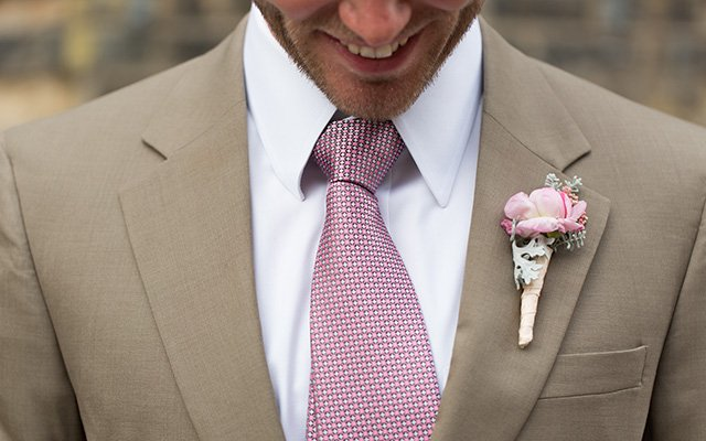 Grooms tie and flower close up