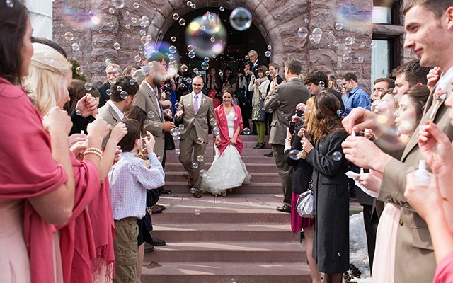 Bride and Groom leaving the building people blowing bubbles