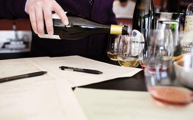 Nick Rancone of Corner Table tweaking the wine list.