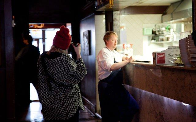 Eliesa Johnson photographing Landon Schoenefeld at Haut...