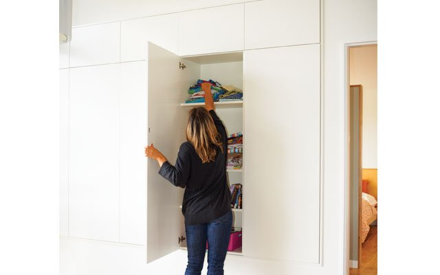 Hidden storage in the living room for a sleek look insi...