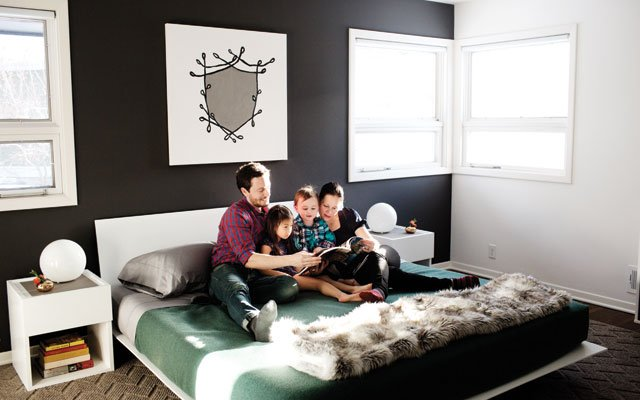 The shield painting in the master bedroom is by Honeysh...