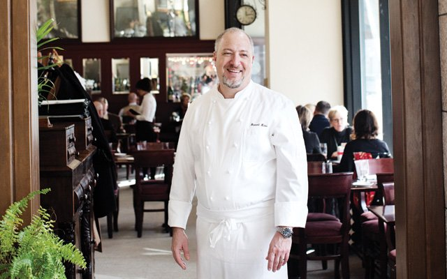 Russel Klein stands in his restaurant, Meritage