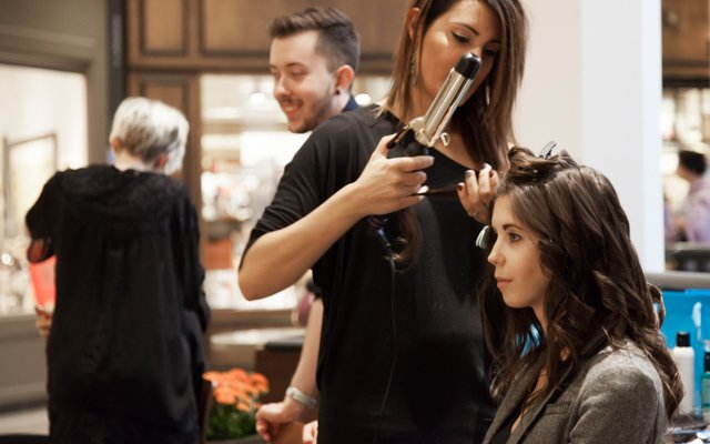 A model getting her hair done for the Fall Fashion Live...