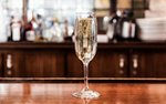 A glass of Prosecco on the bar at 112 Eatery in Minneapolis