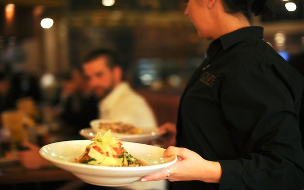 A server at Crave at Shops at West End in St. Louis Park