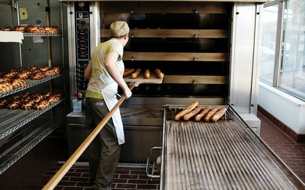 A baker making loaves of bread at Rustica Bakery Minneapolis | Photo by Eliesa Johnson