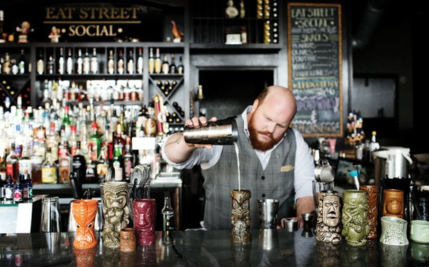 Nick Kosevich behind the bar at Eat Street Social in Minneapolis