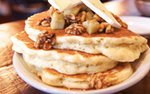 Pancakes topped with butter and walnuts at Colossal Cafe