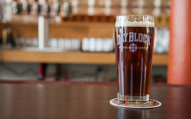 A glass of beer on the bar at Day Block Brewing in Minneapolis