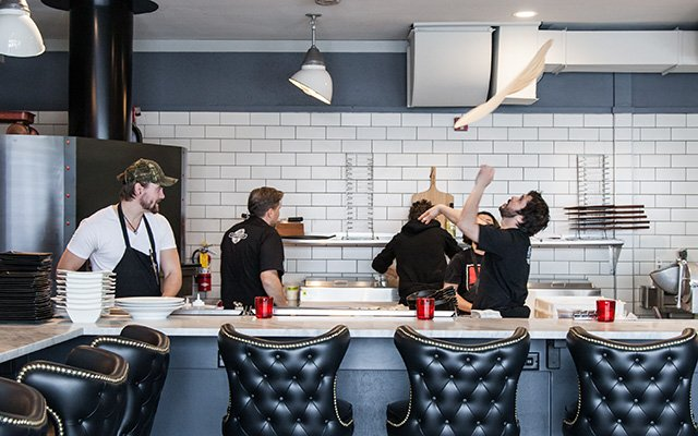 Staff making pizzas at Red Wagon Pizza Co. in Minneapolis