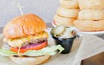 A burger and stacked onion rings at 7th Street Social in St. Paul