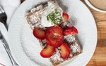 A waffle with fruit and whipped cream at L'Etoile du Nord in Bayport