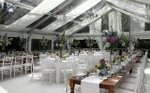 A tent set up for a wedding by Après Party and Tent Rental