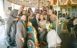 A bridal party on the carousel at the Como Park Zoo & Conservatory