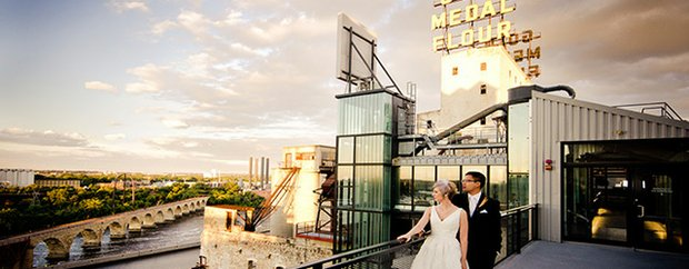 Couple on rooftop overlooking Minneapolis under the Gold Medal Flour sign