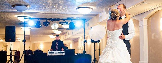 Bride and groom on dance floor with DJ
