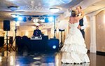 Bride and groom on dance floor with DJ