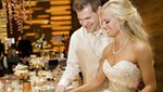 A bride and groom cutting their wedding cake at Loews Hotel Minneapolis