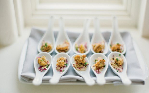 Bite-sized fried oysters by D'Amico Catering