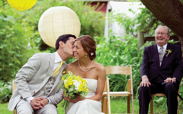 A bride and groom on their wedding day, photographed by Olive Juice Studios