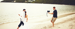 Capture Studios films a bride and groom running on the beach