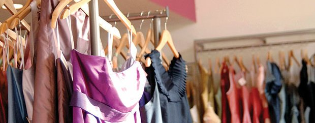A rack of sample gowns at Flutter Boutique