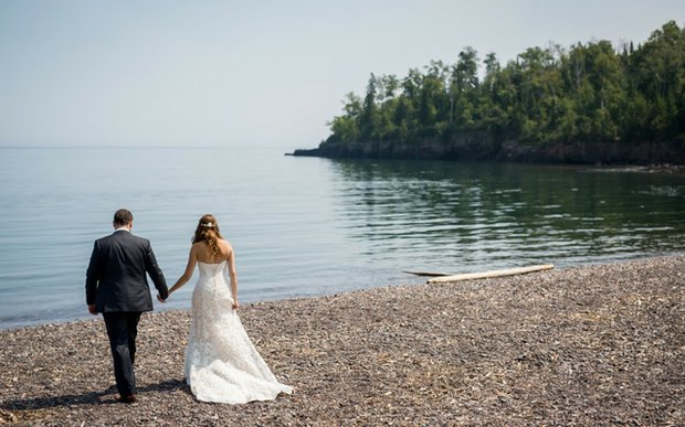 A bride and groom on the beach at Superior Shores Resort in Two Harbors, MN