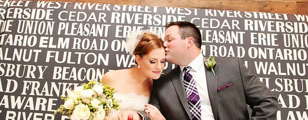 A groom kisses his bride at their wedding at the Commons Hotel