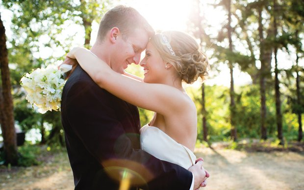 A bride and groom look into one another's eyes on their wedding day