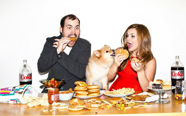 Falen Bonsett and Paul (Meatsauce) Lambert eating cheeseburgers in their engagement photo.