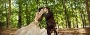 A bride and groom kiss on their wedding day / photo by Dan's Photography