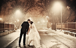 A bride and groom kiss on their winter wedding day. Photo by Fishtale Photography