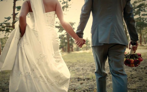 A bride and groom holding hands | Sky Focus Films