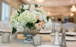 A floral centerpiece designed by Violet's Flowers