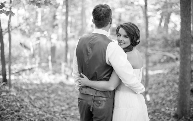 Stephani and Eric Johnson on their wedding day in Faribault, Minnesota | Photo by V Square Media